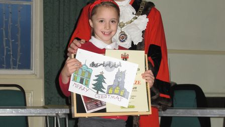 Winner of the Sudbury Christmas Card contest, Grace Hiskett, from St Gregory Primary School, with De