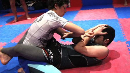 Wendy McKenna, left, is back in action in her third pro fight at BCMMA 20. Picture: STEVE ARGENT