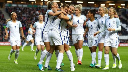 Ellen White of England (9) celebrates with team-mates as she scores their first goal during the wome