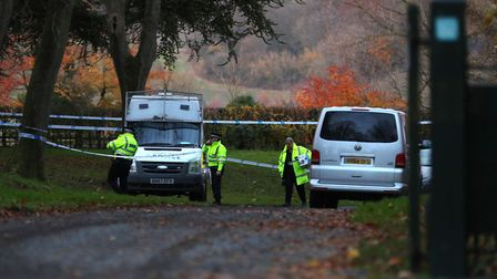 Police at the scene of a mid-air crash near Waddesdon, in Buckinghamshire. Picture: AARON CHOWN/PA W