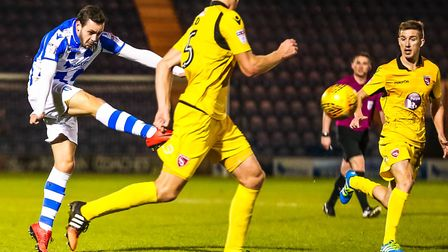Drey Wright strikes the bar with this late shot against Morecambe. Picture: STEVE WALLER