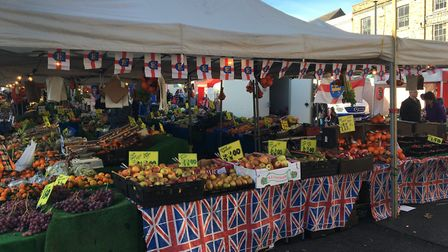 Market traders also got into the act decorating their stalls with flags and bunting. Picture: MICHAE