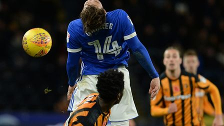 Joe Garner misses his header after being nudged in the back at Hull: Picture Pagepix