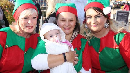 Santa arrives at Notcutts Garden Centre in Woodbridge. 13 week old Dolly-Rose Mordecai with the elve