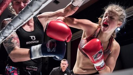 Hannah Turner, right, lands a punch during her win over Bryony Tyrell at Super Fight Series. Picture