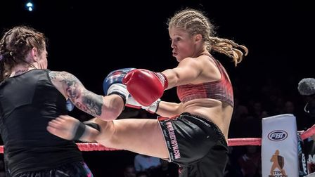 Hannah Turner lands a kick on Bryony Tyrell on the way to victory at the Super Fight Series. Picture