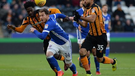 Joe Garner is sandwiched at Hull during the first half. Photo: Pagepix