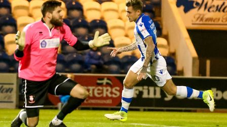 Sammie Szmodics wheels away after giving Colchester an early lead in the League Two match against Li