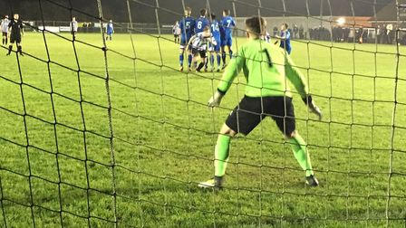 Bury keeper Luis Tibbles watches as a Dereham free-kick curls past the defensive wall but drops wide