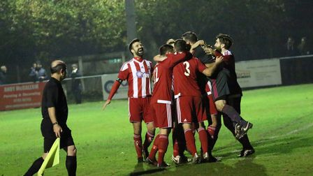 Felixstowe players celebrate after their penalty shoot-out win. Picture: ROSS HALLS