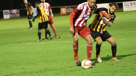 Felixstowe's Jamal Wiggins protects the ball from Angelo Harrop. Picture: ROSS HALLS