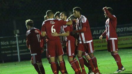 Felixstowe players celebrate Joe Francis's goal from the spot. Picture: ROSS HALLS