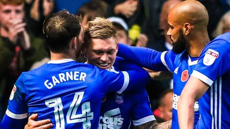 Martyn Waghorn celebrates with team-mates Joe Garner and David McGoldrick after giving Town a 1-0 le