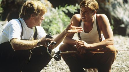 Roberrt Redford talking to Brad Pitt on the set of A River Runs Through It, a drama looking at famil