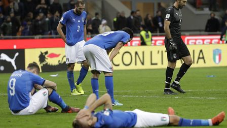 Italian players react to their elimination at the end of the World Cup qualifying play-off second le