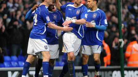 Jason Scotland celebrates with his team mates as Town draw 1-1 with Hull City at Portman Road in Feb