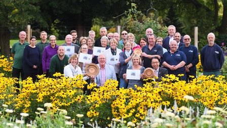 Bury in Bloom team celebrate their success in Abbey Gardens. The town has now been put forward to th
