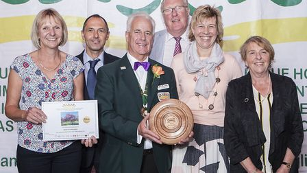 The Bury in Bloom team celebrate winning best overall entry among a host of other awards at the pres