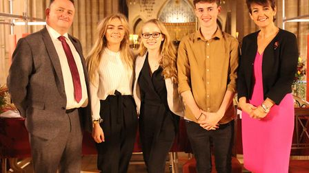 Year 13 students Chloe Jameson, Keely Wright, and Isaac Melvin with headteacher Lee Walker and MP fo