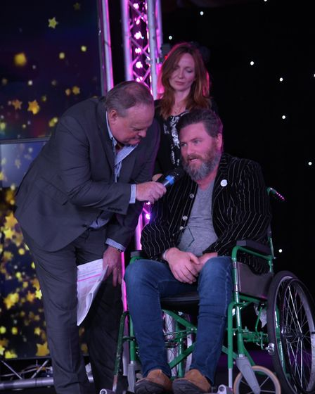 Mark Murphy chatting to Unsung Hero of the Year Mat Bayfield with his fiance Kelly Pritchard. Pict