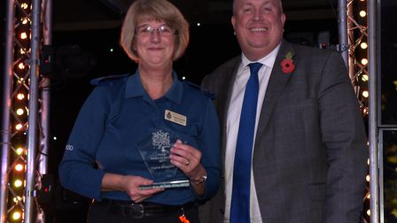 Police Person of the Year, Ginny Shoesmith, receiving her award from Suffolk County Council leader,
