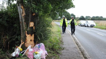 Floral tributes following the accident on the B115 near Chilton Airfield. Picture: SARAH LUCY BROWN
