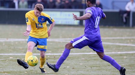 Jamie Eaton-Collins of Sudbury, left, in action at King's Marsh on Saturday, where the Suffolk side