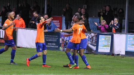 Dernell Wynter has just opened the scoring for Iron and the celebrations begin. Photo:JON WEAVER