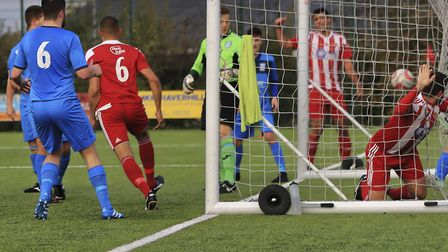 Rhys Barber and the ball are both in the back of the net as Felixstowe�s Dan Davis wheels away to ce