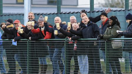 Travelling Seasider fans at Haverhill Borough celebrate with a warming cup of coffee. Photo: STAN BA