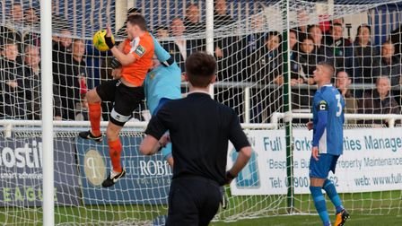 BURY JOY: Ollie Hughes bundles the ball over the line to put Bury into the lead at Billericay on Sat