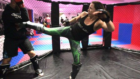Kerry Hughes sparring with BKK Fighters head coach Jack Mason in Colchester. Picture: ARCHANT