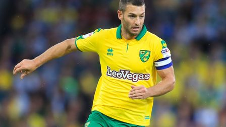 Norwich City's Wes Hoolahan wearing this year's yellow and green kit. Picture: PA