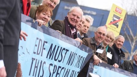 Members of Sizewell C protest group TEAGS with protest banners outside Endeavour House before a Suff