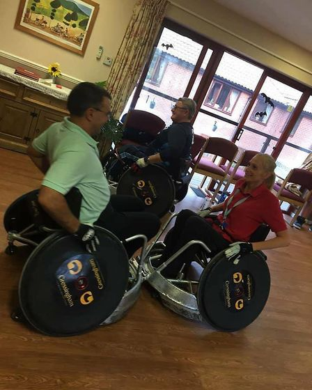 Staff and residents were encouraged to have a go. Pictures: Cardinal Healthcare Group