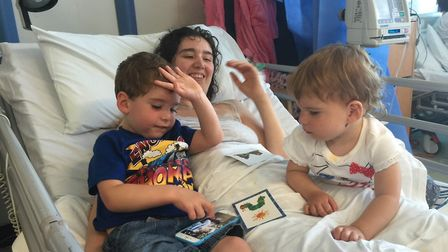 Annie Hughes in hospital visited by children Noah Lily. Picture: FAMILY