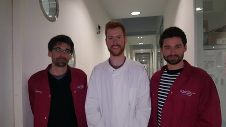 Ben and Henry Dunham with James Boot, centre, at the research centre. Picture: BRAIN TUMOUR RESEARCH