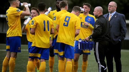 AFC Sudbury boss Mark Morsley, far right, takes his team to Ware this weekend.