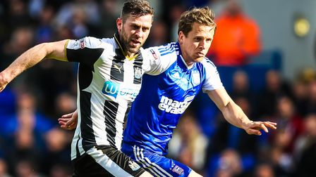 Christophe Berra, pictured battling with former Blue Daryl Murphy. Picture: STEVE WALLER