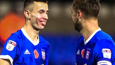 Bersant Celina celebrates with skipper Luke Chambers at the final whistle. Picture: STEVE WALLER