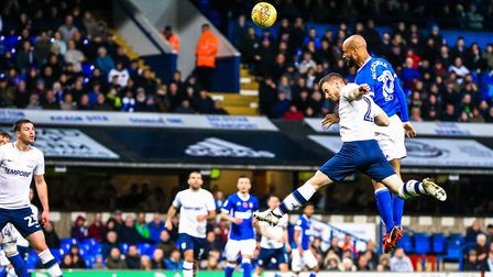 David McGoldrick fends off the challenge of Marnick Vermijl to head Town into a 2-0 lead.. Pictur