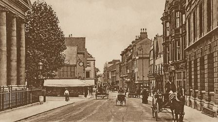 Looking down a busy Abbeygate Street in about 1900. Picture: AMBERLEY PUBLISHING