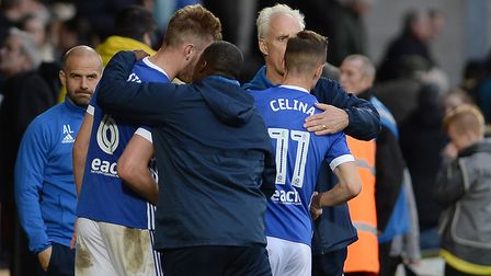 Bersant Celina gets a pat on the back from Mick McCarthy after the final whistle at Burton Albion Pi