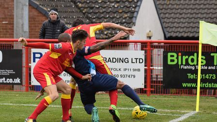 Needham and Arlesey players battle for possession. Photo; BEN POOLEY