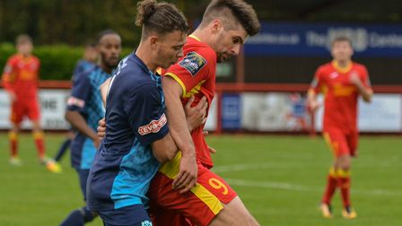 Jaimie Griffiths battles with an Arlesey player during Needham's win on Saturday. Photo: BEN POOLEY