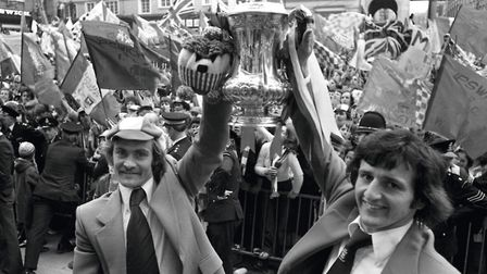 Mick Mills and Roger Osborne celebrate the FA Cup victory with huge crowds on the Cornhill in Ipswic