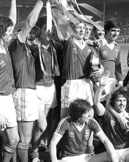 The Town team celebrates after beating Arsenal 1-0 at Wembley. Picture: ARCHANT