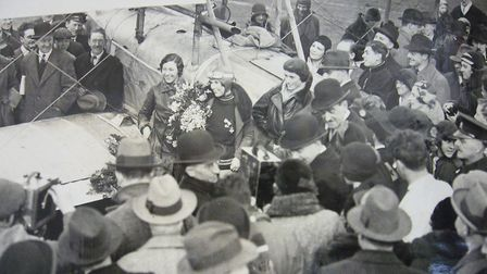 Mildred is greeted by Amy Johnson and Winfred Spooner at Croydon, following her round-the-world flig
