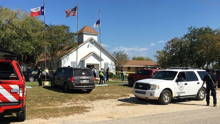 Emergency personnel respond to a fatal shooting at a Baptist church in Sutherland Springs, Texas. Pi