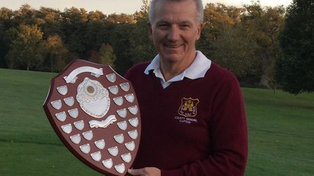 Suffolk Seniors' captain Kevin Brooks holds the East Anglian Daily Times Shield won back from North